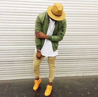 How to wear: yellow low top sneakers, tan sweatpants, white crew-neck t-shirt, olive bomber jacket