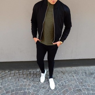 How to wear: white leather low top sneakers, black sweatpants, olive crew-neck t-shirt, black bomber jacket