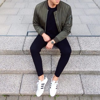 How to wear: white and black leather low top sneakers, black sweatpants, black crew-neck t-shirt, dark green bomber jacket