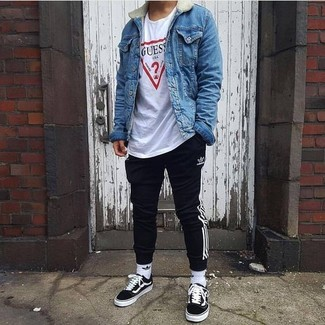 How to wear: black low top sneakers, black and white vertical striped sweatpants, white print crew-neck t-shirt, blue denim jacket