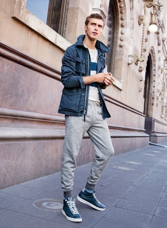 How to wear: navy leather high top sneakers, grey sweatpants, white and navy horizontal striped crew-neck t-shirt, navy parka