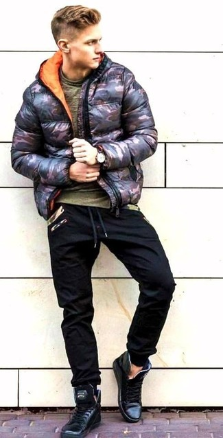 How to wear: black leather high top sneakers, black sweatpants, olive crew-neck t-shirt, black camouflage puffer jacket
