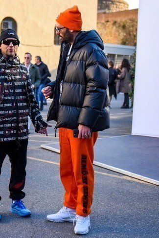 How to Wear a Black Puffer Jacket For Men: This combo of a black puffer jacket and orange print sweatpants is undeniable proof that a safe casual outfit doesn't have to be boring. Rounding off with white athletic shoes is a simple way to introduce a more casual aesthetic to your getup.