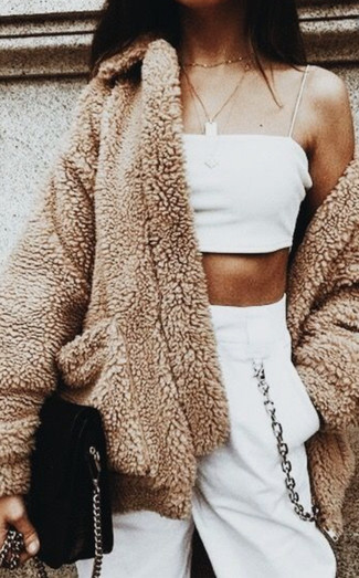 How to wear: black suede crossbody bag, white sweatpants, white cropped top, camel fleece coat