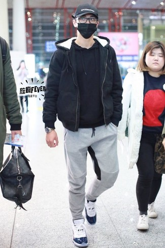 How to wear: white high top sneakers, grey sweatpants, black hoodie, black bomber jacket