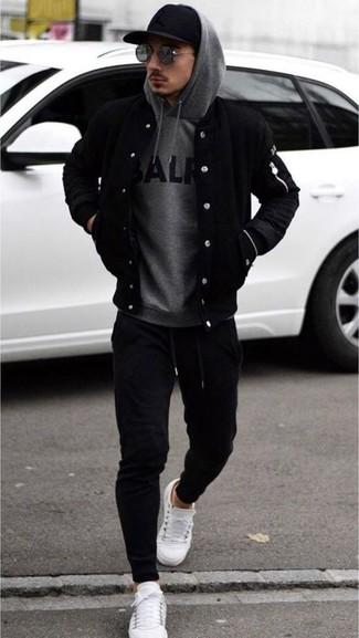 How to wear: white leather low top sneakers, black sweatpants, grey print hoodie, black bomber jacket