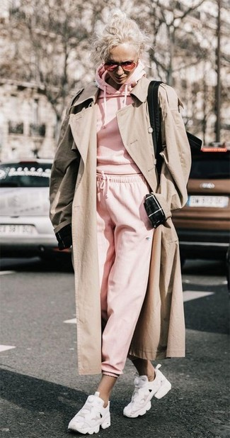 How to wear: white athletic shoes, pink sweatpants, pink hoodie, beige trenchcoat