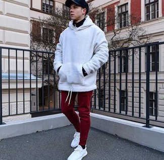 How to wear: white canvas low top sneakers, burgundy sweatpants, white hoodie, black zip neck sweater