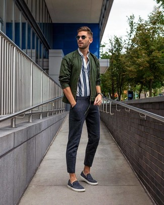 How to wear: navy canvas slip-on sneakers, navy sweatpants, white and navy vertical striped long sleeve shirt, dark green bomber jacket