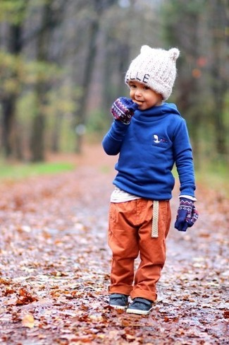 How to Wear a White Long Sleeve T-Shirt For Boys: Suggest that your little one reach for a white long sleeve t-shirt and orange sweatpants for a fun day in the park. For footwear go for a pair of navy leather sneakers.