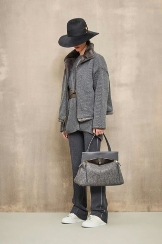 How to wear: white leather low top sneakers, charcoal sweatpants, grey wool tunic, grey fur collar coat