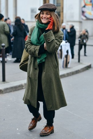 How to wear: brown leather boat shoes, black sweatpants, black turtleneck, olive coat