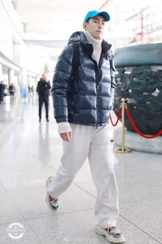 How to wear: grey athletic shoes, white sweatpants, white knit turtleneck, navy puffer jacket