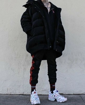 How to wear: white print athletic shoes, red and black vertical striped sweatpants, black zip neck sweater, black puffer coat