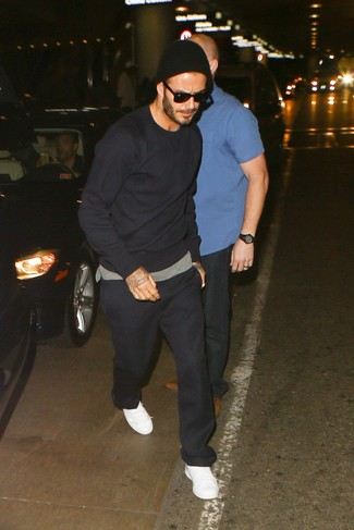 David Beckham wearing Black Sweatshirt, Grey Crew-neck T-shirt, Black Sweatpants, White Leather Low Top Sneakers