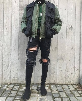 How to wear: black ripped skinny jeans, dark green sweatshirt, black gilet, olive bomber jacket