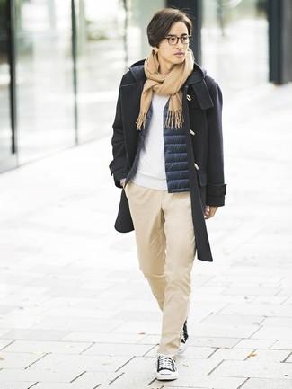 How to wear: khaki chinos, white sweatshirt, navy gilet, black duffle coat