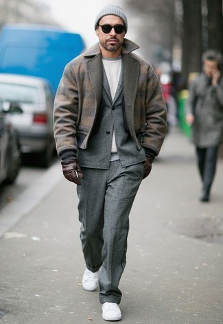 How to wear: white canvas low top sneakers, white sweatshirt, grey wool suit, brown wool bomber jacket