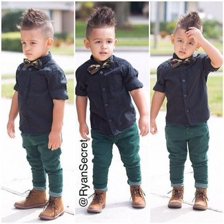 How to wear: dark green bow-tie, tan boots, green jeans, black short sleeve shirt