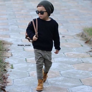 How to wear: charcoal beanie, tan boots, grey jeans, navy sweater