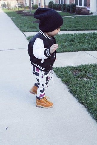 How to wear: black beanie, tan boots, white and black sweatpants, black bomber jacket