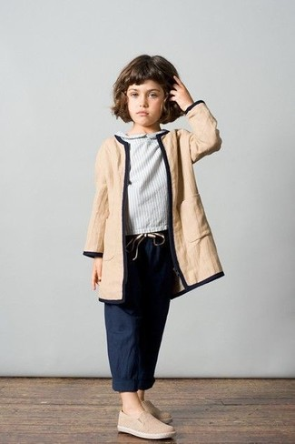 How to wear: tan coat, grey long sleeve blouse, navy trousers, beige sneakers