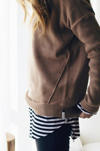 How to wear: tan crew-neck sweater, black and white horizontal striped long sleeve t-shirt, black skinny jeans