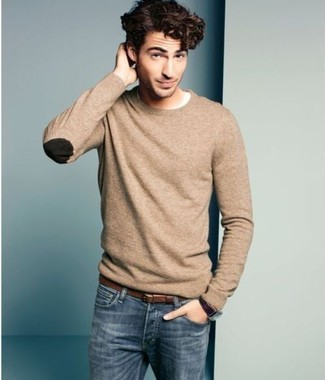 A tan crew-neck sweater and blue jeans is a savvy combination to add to your styling repertoire. Keep this combo ready to go come warmer weather, and rest assured, you'll save a lot of time racking your brain for what to wear on more than one morning.
