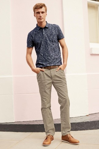 How To Wear a Polo With Desert Boots: A polo and khaki chinos are the kind of a foolproof casual outfit that you need when you have no extra time to dress up. You know how to lift up this outfit: desert boots.