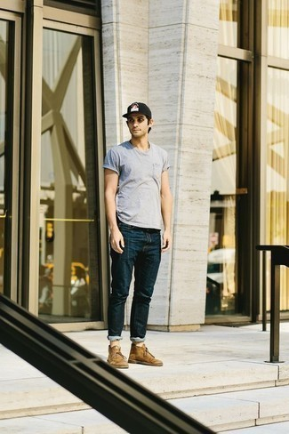 How to Wear Tan Suede Desert Boots: You'll be amazed at how easy it is for any guy to pull together this relaxed casual getup. Just a light blue crew-neck t-shirt married with navy jeans. Complete this look with tan suede desert boots to mix things up a bit.