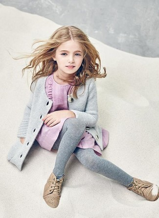 How to Wear Pink Dress For Girls: Suggest that your girl choose pink dress and a grey cardigan for a glam and trendy getup. As far as footwear is concerned, let your child grab a pair of tan desert boots.