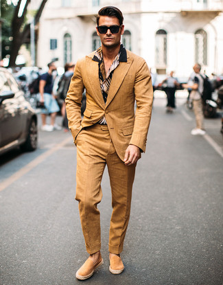 How to Wear Tan Suede Espadrilles For Men: This pairing of a tan suit and a black print short sleeve shirt will hallmark your skills in menswear styling. Finishing off with a pair of tan suede espadrilles is a fail-safe way to infuse a more casual touch into this getup.