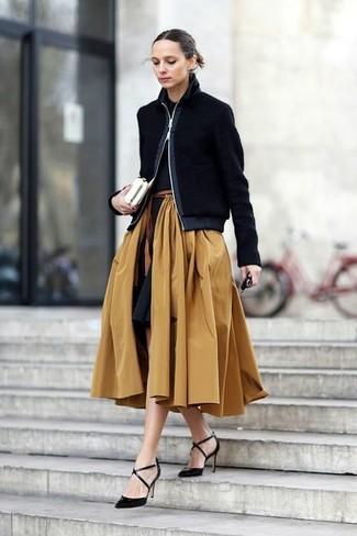 How to wear: black leather pumps, tan full skirt, black polo, black bomber jacket