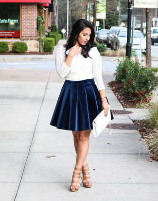 How to wear: white leather clutch, tan leather gladiator sandals, navy velvet skater skirt, white lace long sleeve t-shirt