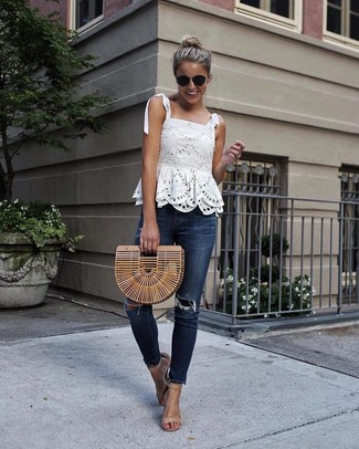 How to wear: tan straw clutch, tan leather heeled sandals, navy ripped skinny jeans, white lace sleeveless top