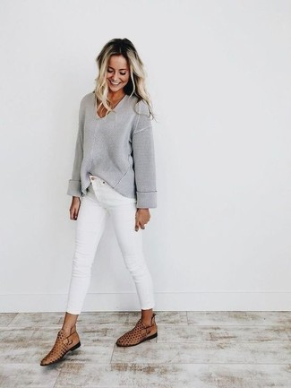 How to wear: tan cutout leather ankle boots, white skinny jeans, grey v-neck sweater