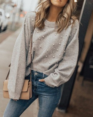 How to wear: tan leather crossbody bag, blue skinny jeans, grey embellished crew-neck sweater