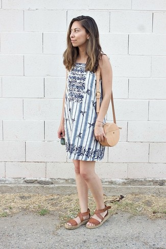 How to wear: tan leather crossbody bag, brown leather flat sandals, white vertical striped shift dress