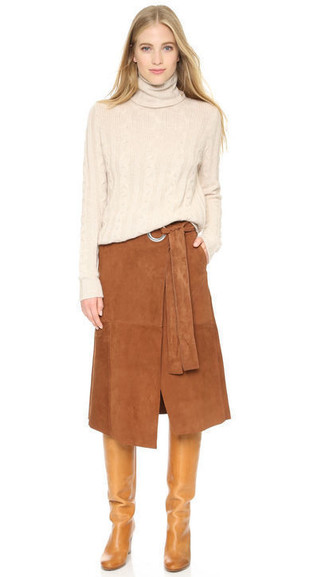 How to wear: tan leather knee high boots, brown suede midi skirt, beige turtleneck