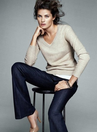 How to wear: tan leather pumps, navy flare jeans, beige v-neck sweater