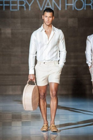 How to wear: beige leather tote bag, tan leather loafers, beige shorts, white vertical striped long sleeve shirt
