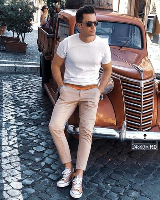 How to wear: navy sunglasses, tan canvas low top sneakers, beige chinos, white crew-neck t-shirt