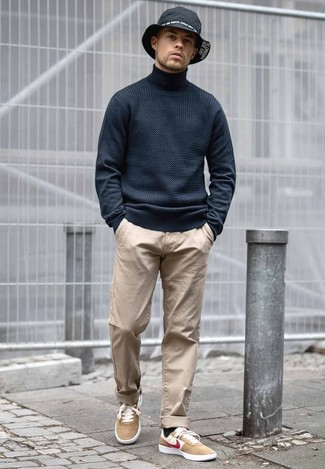 How to Wear a Black Denim Hat For Men: If you prefer relaxed dressing, why not wear this pairing of a black turtleneck and a black denim hat? Complement this look with a pair of tan suede low top sneakers to effortlesslly boost the classy factor of any outfit.