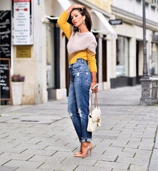 How to Wear Blue Ripped Boyfriend Jeans: If you gravitate towards casual looks, why not wear this combination of a yellow chevron crew-neck sweater and blue ripped boyfriend jeans? Finishing off with a pair of tan leather pumps is a fail-safe way to introduce a bit of flair to your ensemble.