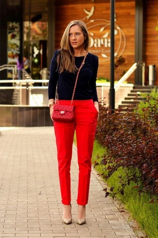How to wear: red quilted leather crossbody bag, tan leather pumps, red tapered pants, navy crew-neck sweater