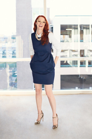 How to wear: beige pearl necklace, tan leopard leather pumps, white dress shirt, navy sheath dress