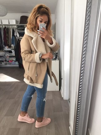 A tan shearling coat and blue ripped skinny jeans is a nice pairing worth integrating into your wardrobe. For footwear go down the casual route with pink low top sneakers. When staying inside on a frosty winter day is not an option, this look just might get you through the day.