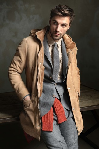 How to wear: tan shearling coat, grey wool suit, beige dress shirt, grey polka dot wool tie