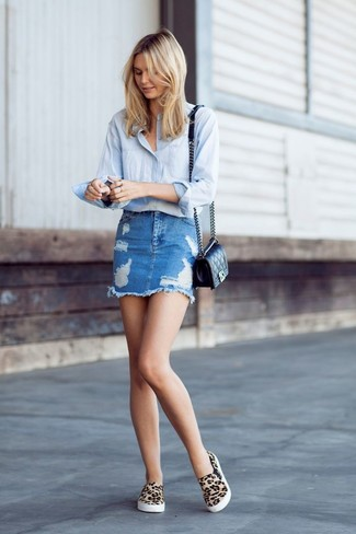 How to wear: black quilted leather crossbody bag, tan leopard slip-on sneakers, blue ripped denim mini skirt, light blue dress shirt