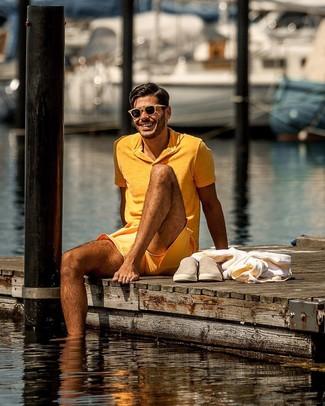 How to wear: tan sunglasses, tan suede slip-on sneakers, orange shorts, orange polo